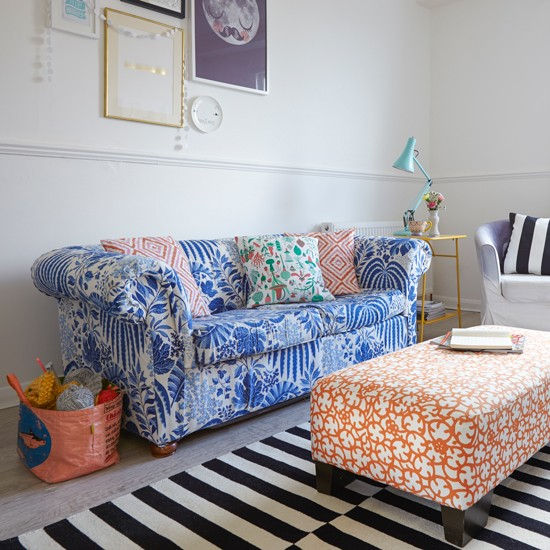 Living Room With Colourful Furniture And Striped Rug