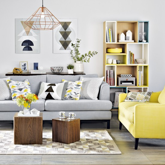 yellow and grey living room with geometric prints  grey