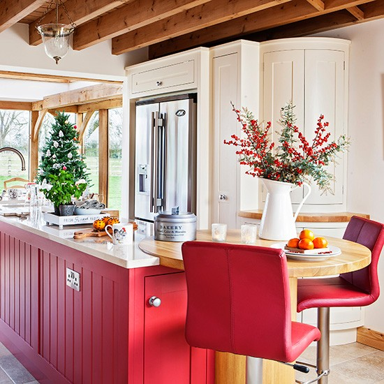 Country Kitchen With Red Island And Breakfast Bar