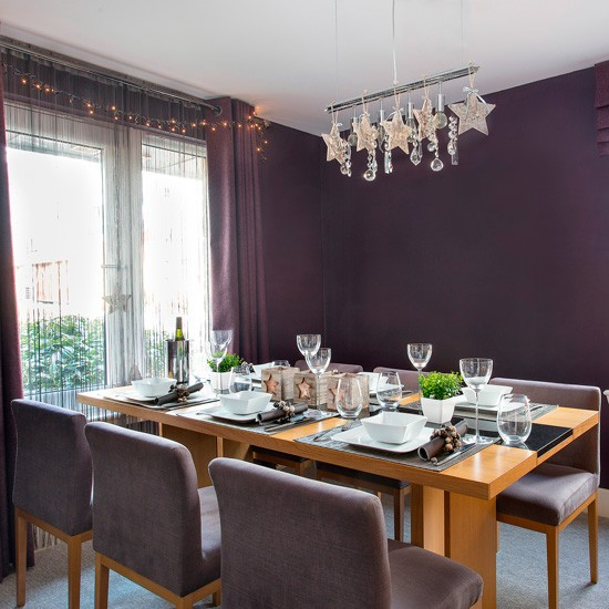 Dining Room With Dark Purple Walls And Wooden Table