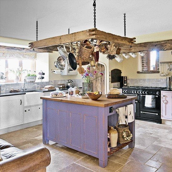 Rustic kitchen with ceiling-hung pan rack and purple ...