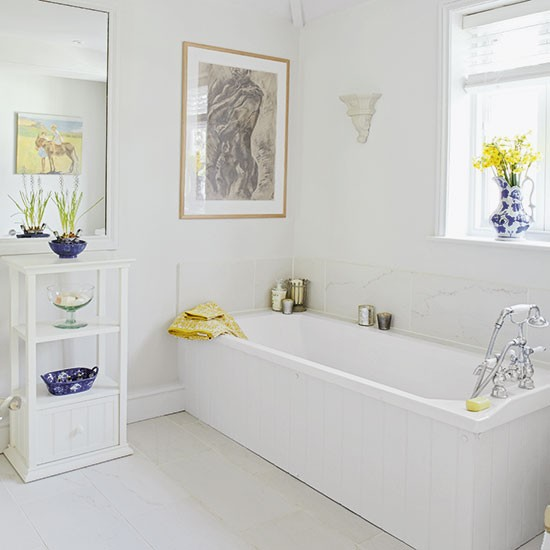 White Bathroom With Yellow And Blue Accessories