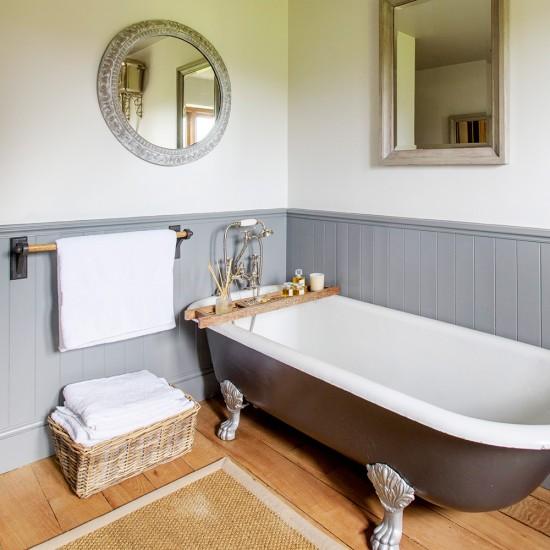 Country Bathroom With Grey Roll Top Bath And Dado