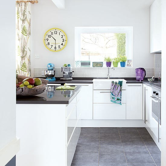 U Shaped Kitchen With Island Unit In Black And White