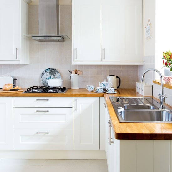 A Modern Bright And Airy Kitchen With Wooden Details: White Modern Shaker-style Kitchen With Wooden Worktops