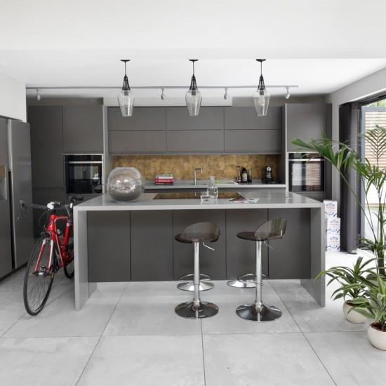 Our Best Breakfast Bar Ideas For A Stylish Good Morning: Modern Grey Kitchen With Sleek Breakfast Bar
