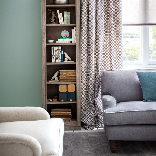 Classic Green Living Room With Tall Bookcase